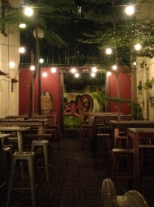 Drunk Monkey's exterior was a alleyway in between the bar and a restaurant next door