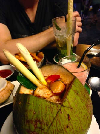 Thai tom yam coconut soup, beautifully presented in a cocount!