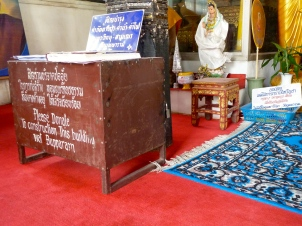 All temples have boxes asking for donations. Often, the specific cause is listed on the box - some temples have MANY boxes.