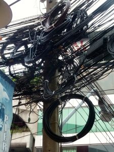 Thailand's idea of how to wire a city. I couldn't stop taking pictures of these the first time I was there!