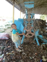 This child lives at the dump and wandered over to the sifter just as I was taking a picture